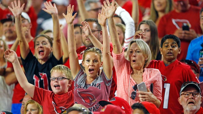 Arizona Cardinals fans cheer during a preseason game against the Kansas City Chiefs on Saturday, Aug. 15, 2015, in Glendale.