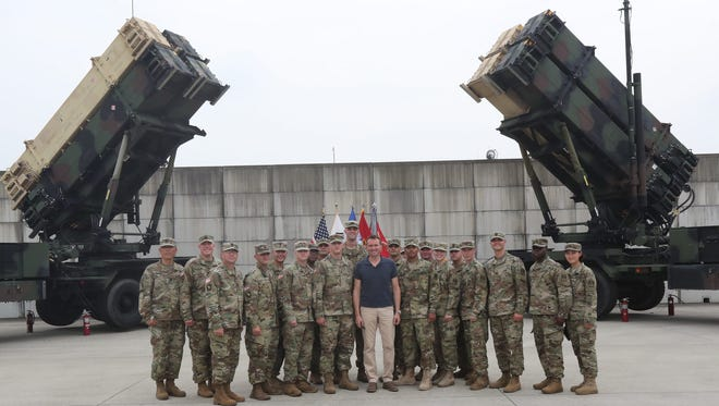 Visiting US Secretary of the Army Eric Fanning (C) poses with US soldiers in front of two Patriot PAC-3 advanced missiles systems during a visit to the 35th Air Defense Artillery Brigade of the US Forces Korea's (USFK) Eighth Army in Osan, south of Seoul, South Korea, 02 August 2016. The brigade in charge of intercepting North Korean missiles is expected to run the Terminal High Altitude Area Defense (THAAD) missile defense system to be deployed in the country's southeastern town of Seongju as well.