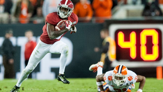 Alabama wide receiver Calvin Ridley (3) carries a reception against Clemson in first half action of the College Football Playoff National Championship Game at Raymond James Stadium in Tampa, Fla. on Monday January 9, 2017. (Mickey Welsh / Montgomery Advertiser)