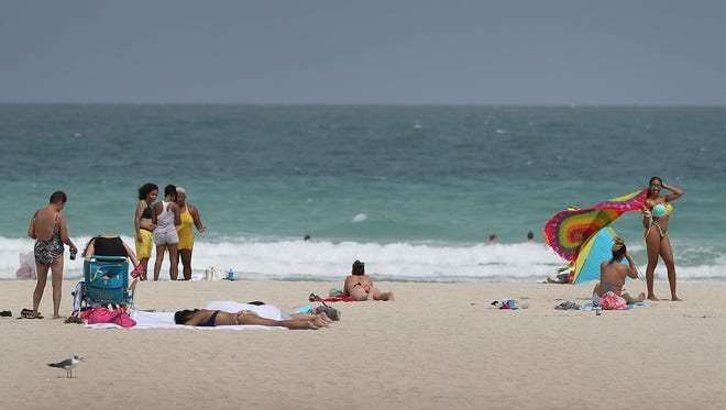 People enjoy themselves on the beach in Florida.
