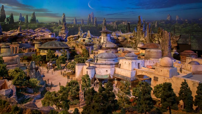 A detailed model of Disney's Star Wars: Galaxy's Edge provides an early look at the new 14-acre land. To accommodate its ongoing construction (it will open May 2019), several attractions were temporarily closed, including the Disneyland Railroad and Rivers of America.