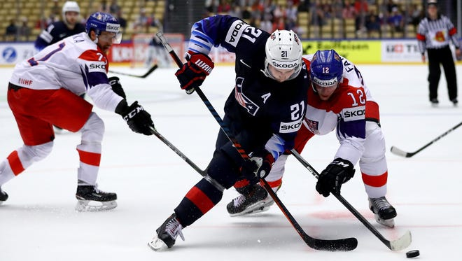 Dylan Larkin (L) of the United States and Radek Faksa of Czech Republic battle for the puck during the 2018 IIHF Ice Hockey World Championship Quarter Final game between United States and Czech Republic at Jyske Bank Boxen on May 17, 2018, in Herning, Denmark