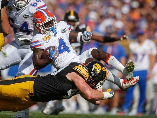 Iowa linebacker Josey Jewell upends Florida receiver