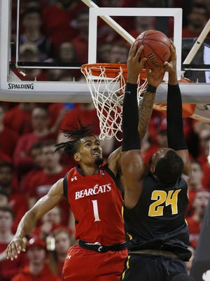 University of Cincinnati guard Jacob Evans III defends Wichita State center Shaquille Morris during Sunday's game, which UC lost 76-72.