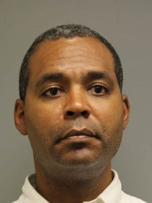 Karl McIntosh, a Wilmington psychiatrist, was indicted on charges he submitted more than $100,000 in insurance claims over a two-year periodfor visits that did not occur.