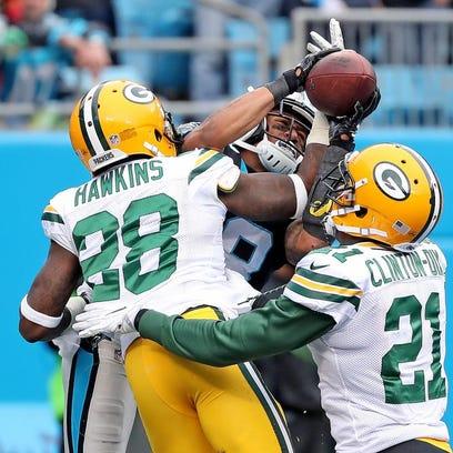 Green Bay Packers cornerback Josh Hawkins (28) and