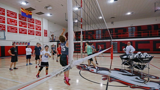 Brophy Prep boys volleyball head coach Tony Oldani (right) directs his team during practice Tuesday, Feb. 24, 2015 in Phoenix.