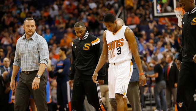Phoenix Suns guard Brandon Knight walks off the court after an injury against the Oklahoma City Thunder during the third quarter at US Airways Center in Phoenix, Ariz. March 29, 2015.