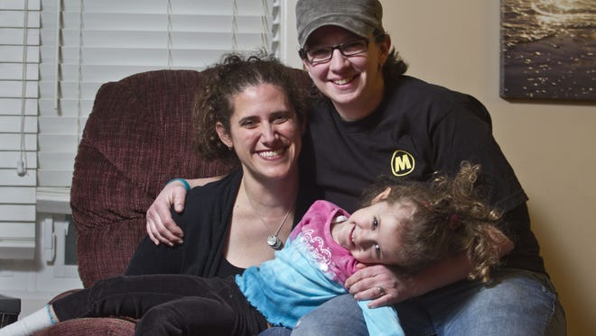 Adrian, Nicole (center) and Denise (top). Same sex couple Denise DePresca and her wife Nicole DePresca talk about their marriage and life with their daughter Adrian, 4, in Freehold