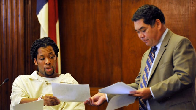 Kenneth Kagonyera answers questions from his attorney Noell Tim in September 2011 during a rare hearing before a three-judge panel to determine his innocence in the 2000 murder of Walter Rodney Bowman.