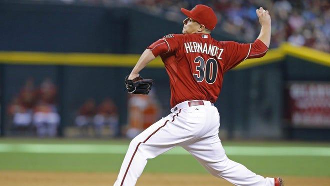 Arizona Diamondbacks relief pitcher David Hernandez (30) throws in the 8th  inning against the  New York Mets  in  their MLB game Sunday, June 7, 2015 in Phoenix, Ariz.