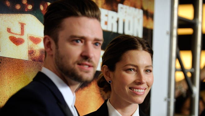 """Singer/actor Justin Timberlake (L) and his wife, actress Jessica Biel, arrive at the world premiere of Twentieth Century Fox and New Regency's film """"Runner Runner"""" at Planet Hollywood Resort & Casino on September 18, 2013 in Las Vegas, Nevada."""