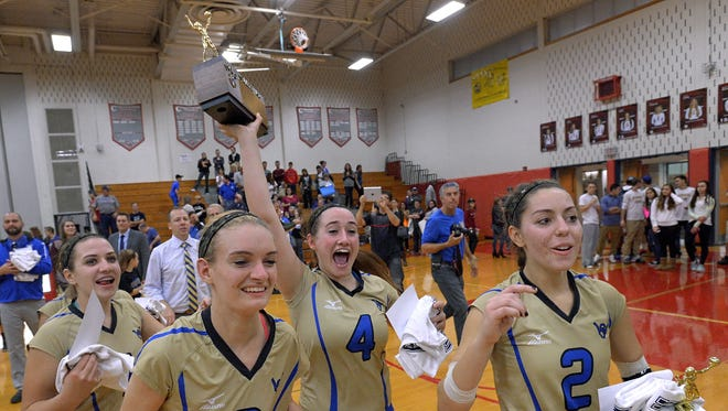 Webster Schroeder's captains carry the championship trophy to their fans following their win in the Section V Class AA Volleyball championship on Nov. 6, 2015.