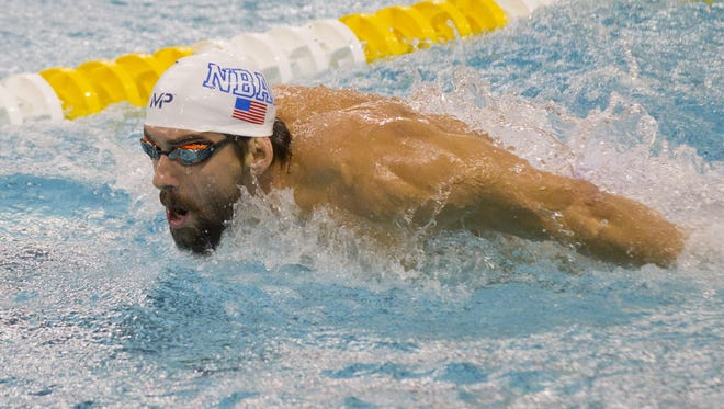 Olympic medal winner Michael Phelps practices the butterfly before competing Wednesday in the Arena Pro Swim Series at the Aquatic Center at the University of Minnesota in Minneapolis.