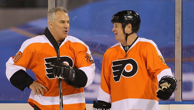 Former Flyers defender Jimmy Watson (left) will be inducted into the team's hall of fame Monday night.