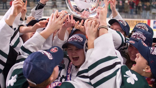 The Vermont Shamrocks U-19 team lifts the national championship trophy after Monday's 2-1 overtime win in the USA Hockey Tier II final at Cairns Arena.