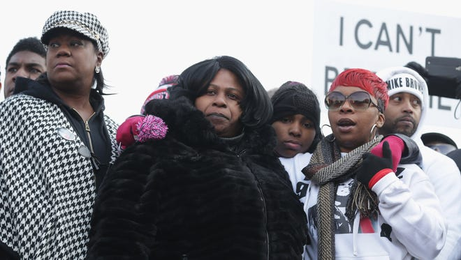 """From left to right, Sybrina Fulton, the mother of Trayvon Martin; Samaira Rice, the mother of Tamir Rice; and Lesley McSpadden, the mother of Michael Brown Jr, at a """"Justice For All"""" march in Washington, D.C., on Dec. 13, 2014."""
