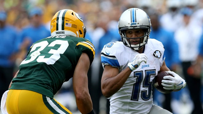 Golden Tate of the Detroit Lions looks to make a move on Micah Hyde of the Green Bay Packers on Sept. 25, 2016, in Green Bay, Wis.
