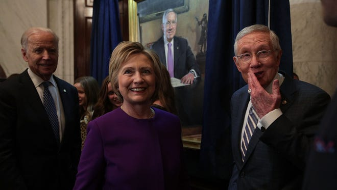 Sen. Harry Reid, right, Hillary Clinton and Vice President Biden at the unveiling of Reid's official portrait on Dec. 8, 2016.