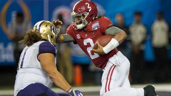 Alabama quarterback Jalen Hurts (2) carries against