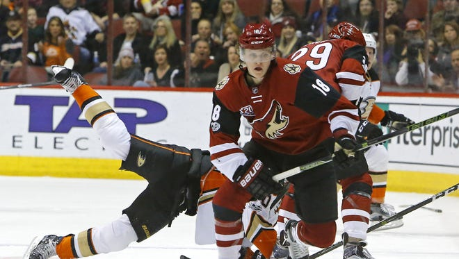 Arizona Coyotes center Christian Dvorak (18) chases down a loose puck against the Anaheim Ducks during the second period of their NHL game Saturday, Jan. 14, 2017 in Glendale, Arizona.