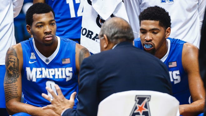The departure of K.J. (left) and Dedric Lawson (right) raises questions about Tubby Smith's ability to keep local talent at Memphis.