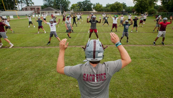 Alabama Christian players warm up during football practice at the ACA campus in Montgomery, Ala. on Monday August 7, 2017.