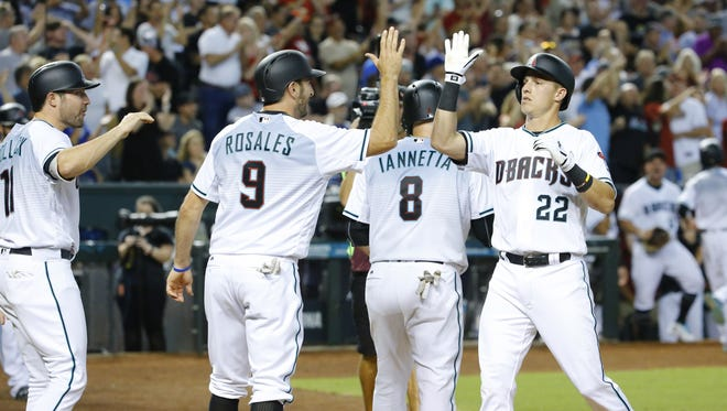 Arizona Diamondbacks third baseman Jake Lamb (22) is greeted at home following his grand slam against the Los Angeles Dodgers in the 7th inning of their MLB game Tuesday, Aug. 8, 2017, in Phoenix,  Ariz.