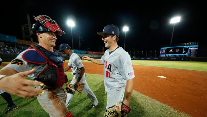 Iowa Hawkeyes pitcher Cole McDonald (11) hugs catcher Tyler Cropley (5) after throwing a no hitter beat the Czech National Team 8-0 Friday, August 25, 2017 in Taipei, Taiwan.