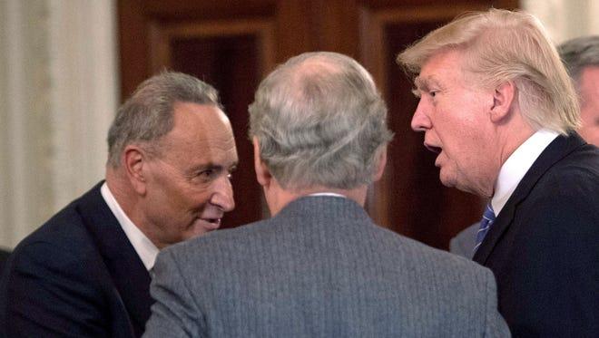 President Trump greets US Senate Minority Leader Chuck Schumer(L), D-NY.