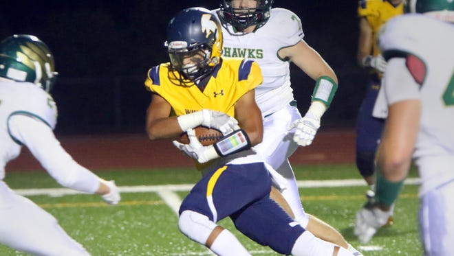 Whitnall's Stephan Flores breaks free for a gain at home against Greenfield on Sept. 28.