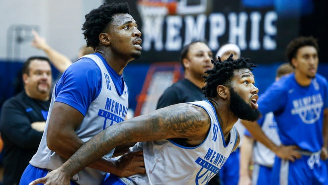 University of Memphis forward Mike Parks Jr. (right) blocks out teammates Victor Enoh (left) during the basketball teams first practice of the 2017-18 season, Friday afternoon at the Larry O. Finch Center.
