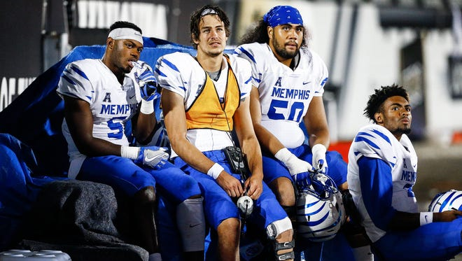 Dejected University of Memphis teammate (left to right) Sean Dykes, Brady Davis, Mannie Lowery, and David Moore watche from the sidelines as the Tigers fall to University of Central Florida 40-13 in Orlando, Fl., Saturday, September 30, 2017.