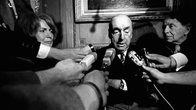 This Oct. 21, 1971 file photo shows Pablo Neruda, poet and then Chilean ambassador to France, talking with reporters in Paris after being named the 1971 Nobel Prize for Literature.