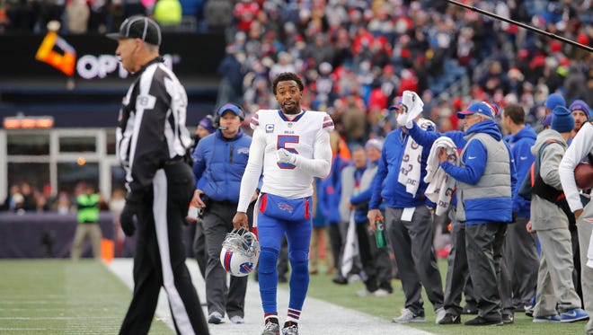 Dec 24, 2017; Foxborough, MA, USA; Buffalo Bills quarterback Tyrod Taylor (5) approaches an officials as a touchdown is reviewed in the last seconds of play against the New England Patriots in the second quarter at Gillette Stadium. Mandatory Credit: David Butler II-USA TODAY Sports