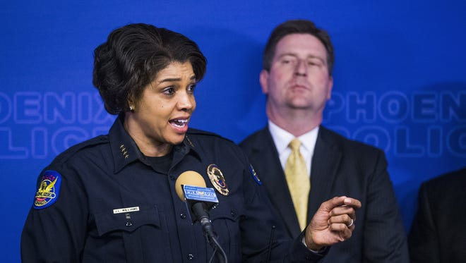 Phoenix Police Chief Jeri Williams discusses the homicides tied to suspect Cleophus Cooksey Jr. at a press conference Jan. 18, 2018, as Phoenix Mayor Greg Stanton looks on.