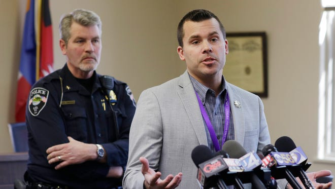 Kiel Superintendant Brad Ebert speaks during a late morning press conference at Kiel City Hall, Friday, March 23, 2018, in KIel, Wis. Kiel High School cancelled classes after shots were heard by a staff member at the high school before classes started at Kiel.  At left is Police Chief Dave Funkhouser.