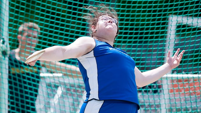 U-32's Molly McCreedy tosses the discus during the 2018 Division II high school track and field state championships on Saturday at South Burlington.