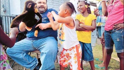 """Lee Brown, then 40, attended a National Night Out at New Hope Ministries where """"Chimmy the safety monkey"""" advised kids on emergency phone numbers and other safety matters in 2011."""