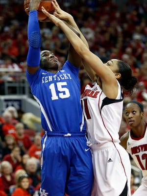 Kentucky's Linnae Harper (#15) goes up hard to collect the points against Louisville's Bria Smith. Dec. 7, 2014