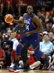 USA's Draymond Green dribbles down the court during an exhibition game against Nigeria, Monday, Aug. 1, 2016, in Houston.
