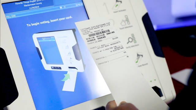 This Oct. 19, 2017, file photo shows a new voting machine which prints a paper record on display at a polling site in Conyers, Ga.