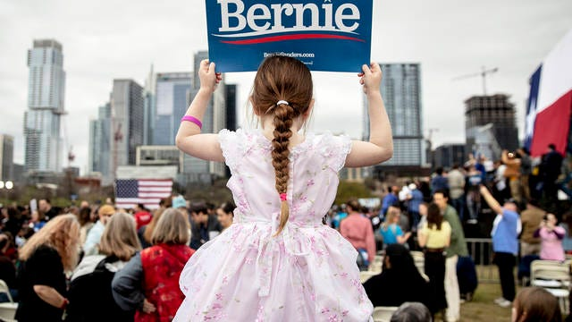 Lily Barbour, 5, holds up a campaign sign for Democratic presidential candidate Sen. Bernie Sanders, I-Vt., during a campaign event in Austin, Texas, Sunday.