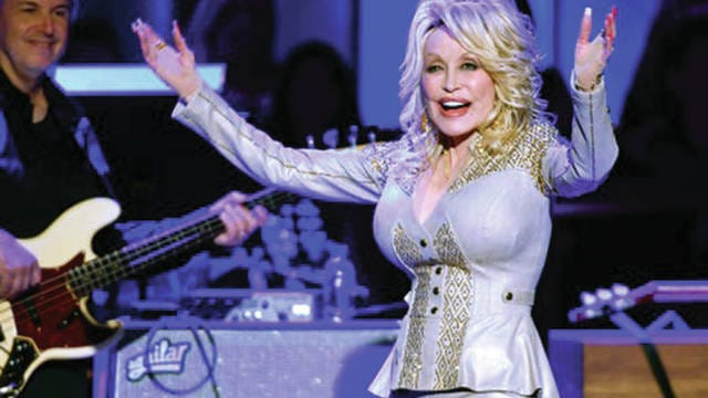 Dolly Parton performs at her 50th Opry Member Anniversary at the Grand Ole Opry.