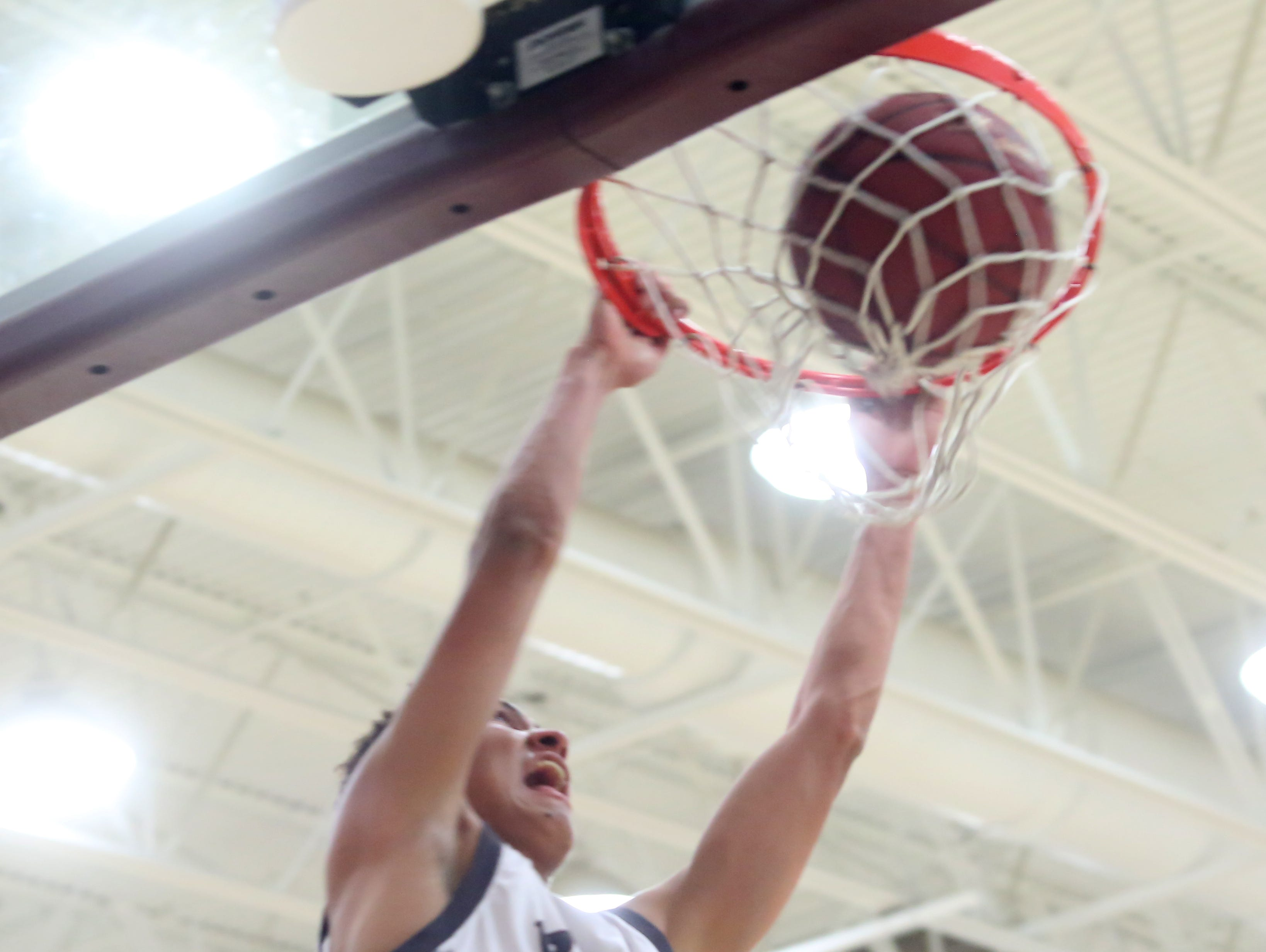 Rancho Mirage High School's Charles Neal dunks the ball against Palm Desert during their game at Rancho Mirage.