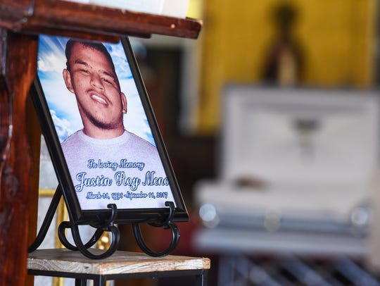 Family, friends and other supporters attend the funeral