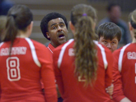 Canton coach Irick Gardner tries to rally his team during Tuesday's Kensington Conference championship match against Novi.
