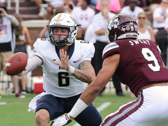 Charleston Southern quarterback Shane Bucenell (6) pitches the ball as Mississippi State defender Montez Sweat (9) puts pressure on him during the first half of an NCAA college football game in Starkville, Miss., Saturday, Sept. 2, 2017.