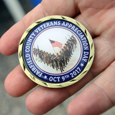 A veteran shows his challenge coin form the veterans