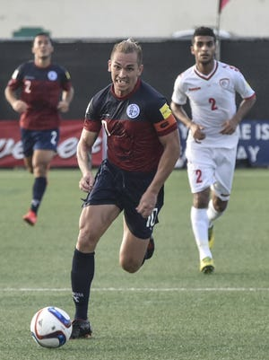 Team Captain Jason Cunliffe breaks away with the ball in the final minutes of a FIFA World Cup Qualifier match against Oman at the Guam Football Association National Training Center in Harmon on Sept. 8.  Cunliffe would be chased down by the speedy Oman defense before getting off a shot.